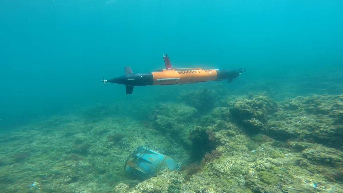 AUVs, Acoustics, and Manned Submarines Ops